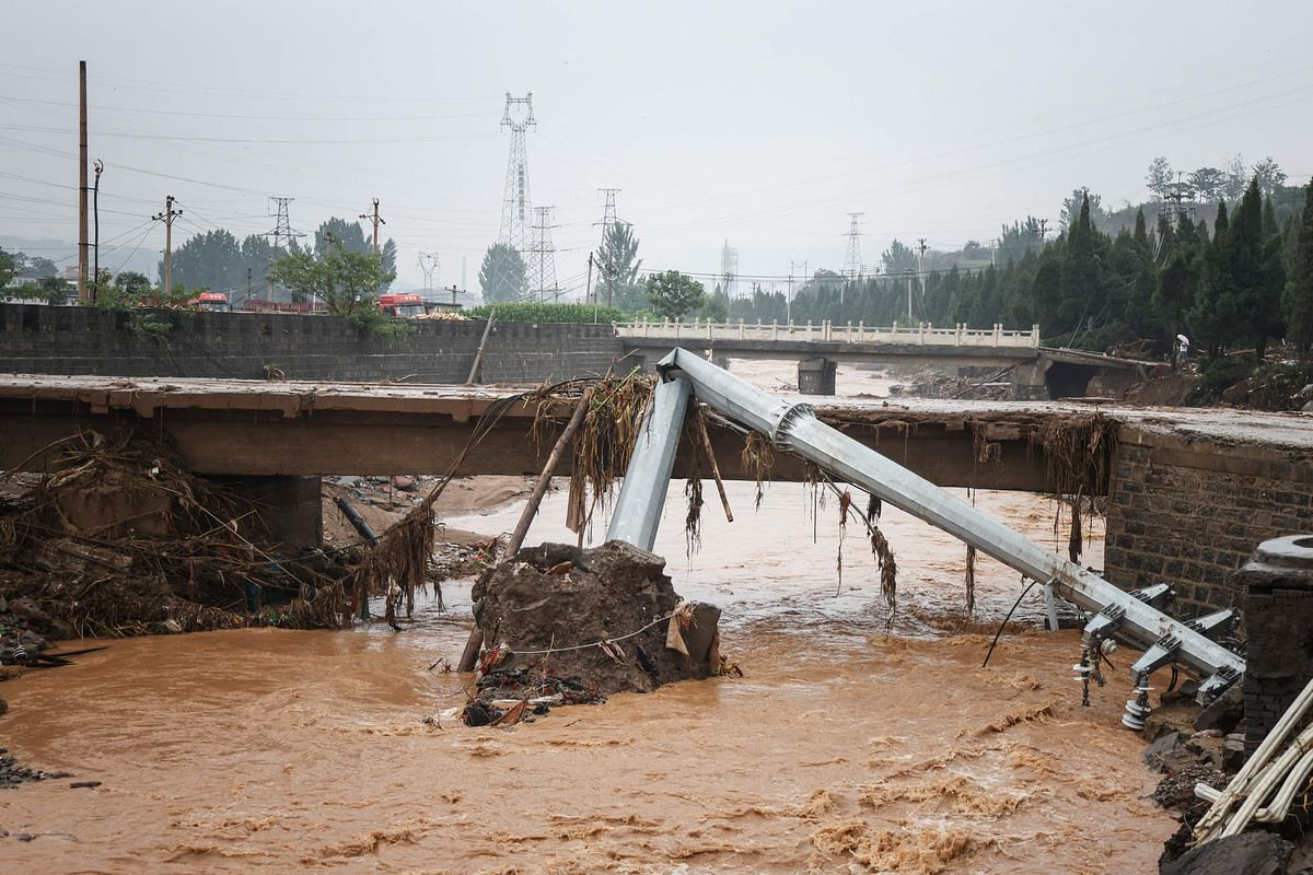 This photo taken on July 21, 2021 shows a utility pole bent in half following heavy rains which caused severe flooding in Gongyi in Chinas central Henan province.