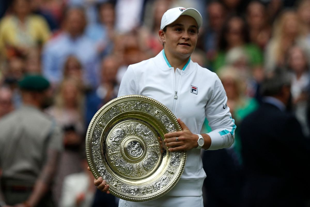 Australias Ashleigh Barty holds the trophy after defeating Czech Republics Karolina Pliskova during their womens singles final match on the twelfth day of the 2021 Wimbledon Championships at The All England Tennis Club in Wimbledon, southwest London, on July 10, 2021.