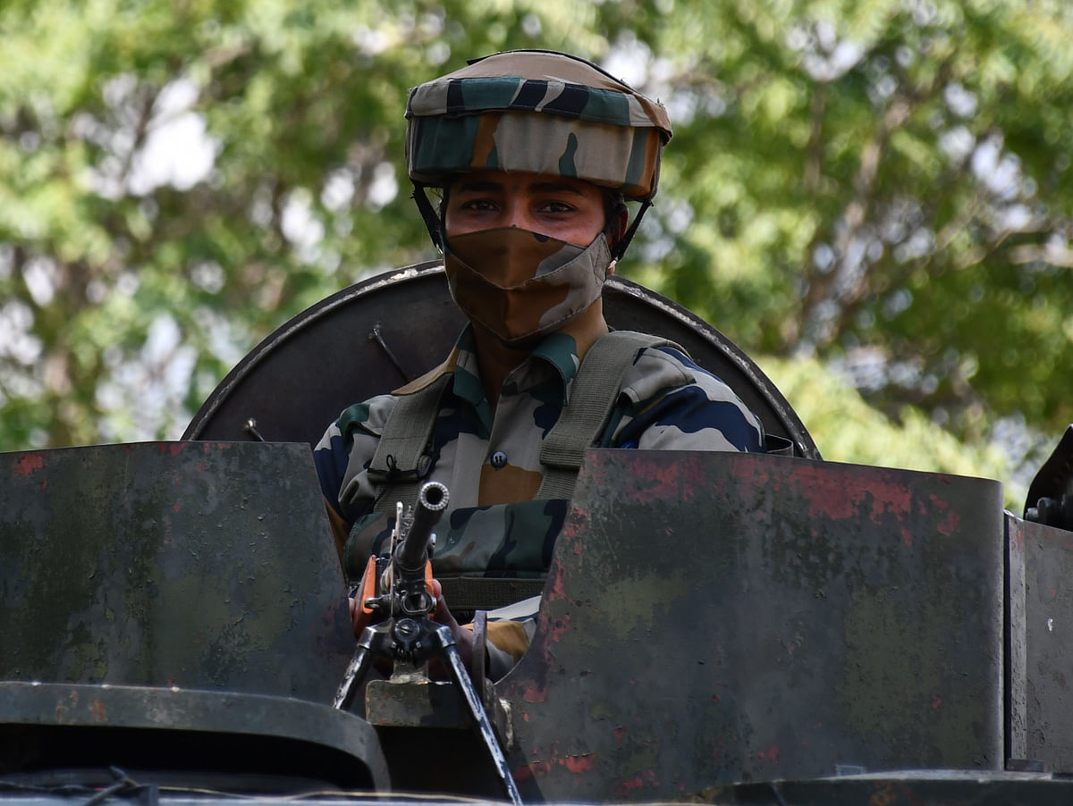 The soldiers seen inside an armoured vehicle at Wasun, in Ganderbal district of Kashmir.