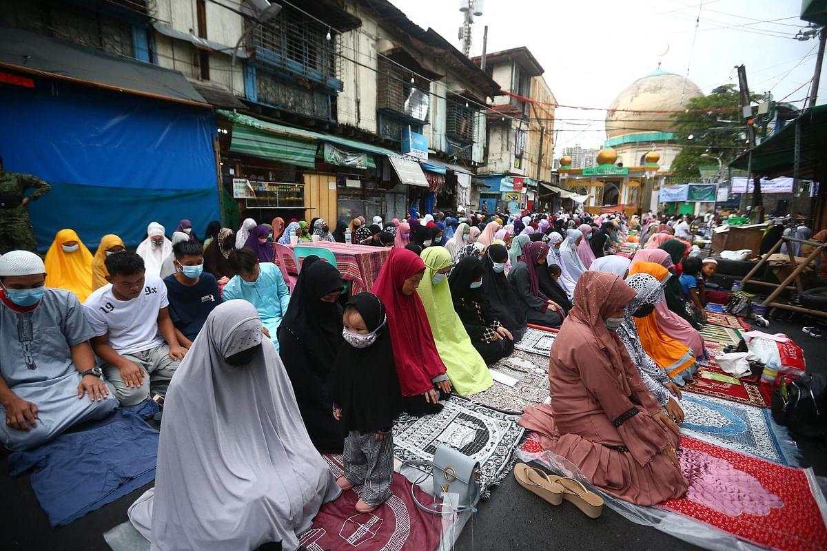Filipino Muslims offer prayers to mark Eid al-Adha outside a mosque in Manila City, suburban Manila on July 20, 2021.