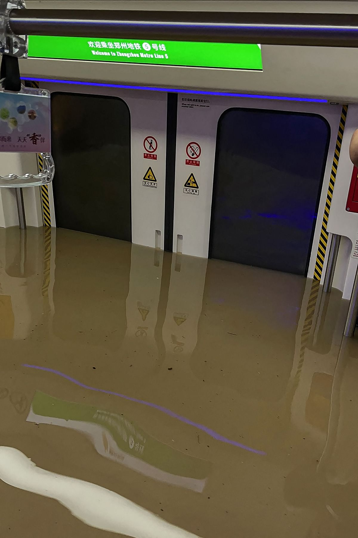 This handout photo taken on July 20, 2021 and received on July 21 courtesy of Weibo user merakiZz-, shows a submerged subway car following heavy rains in Zhengzhou, in Chinas central Henan province.