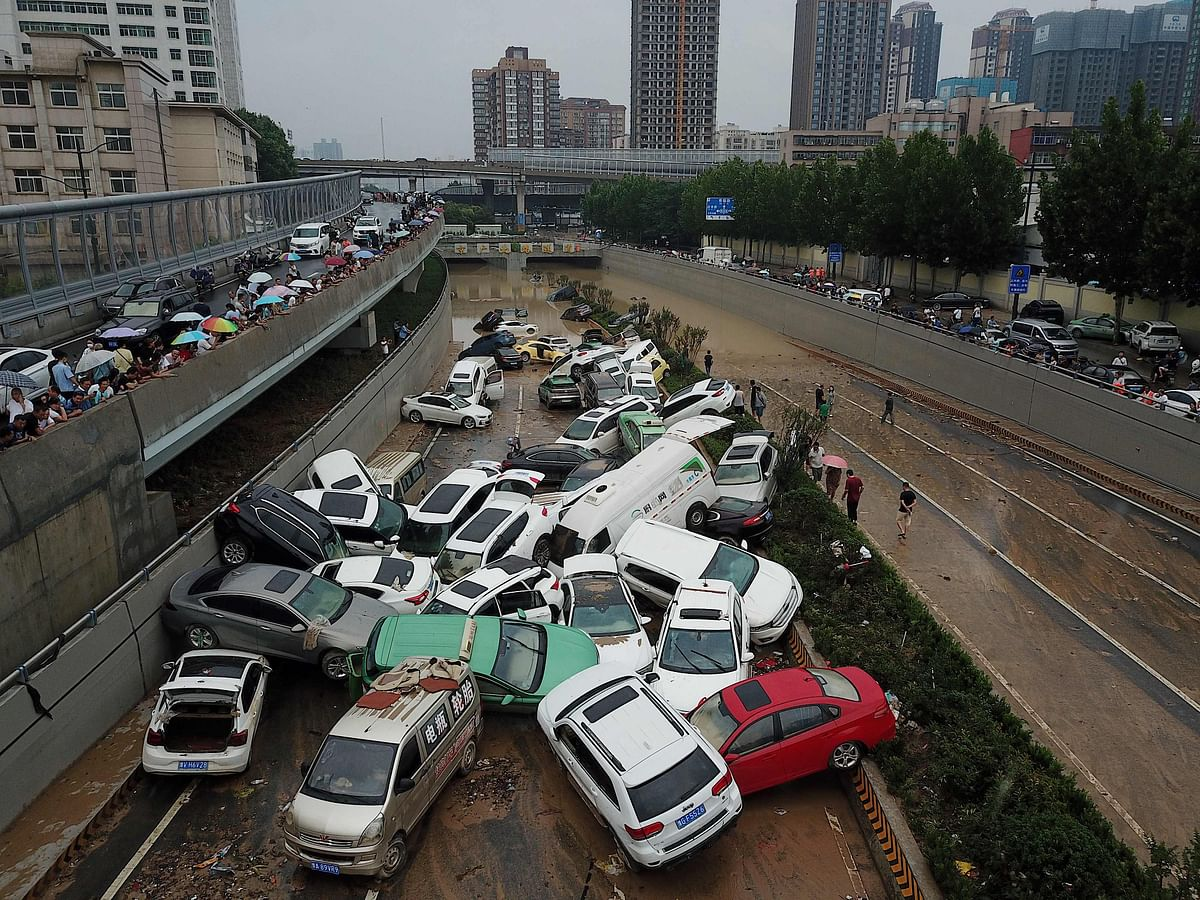 An aerial view shows cars sitting in floodwaters at the entrance of a tunnel after heavy rains hit the city of Zhengzhou in Chinas central Henan province on July 22, 2021.