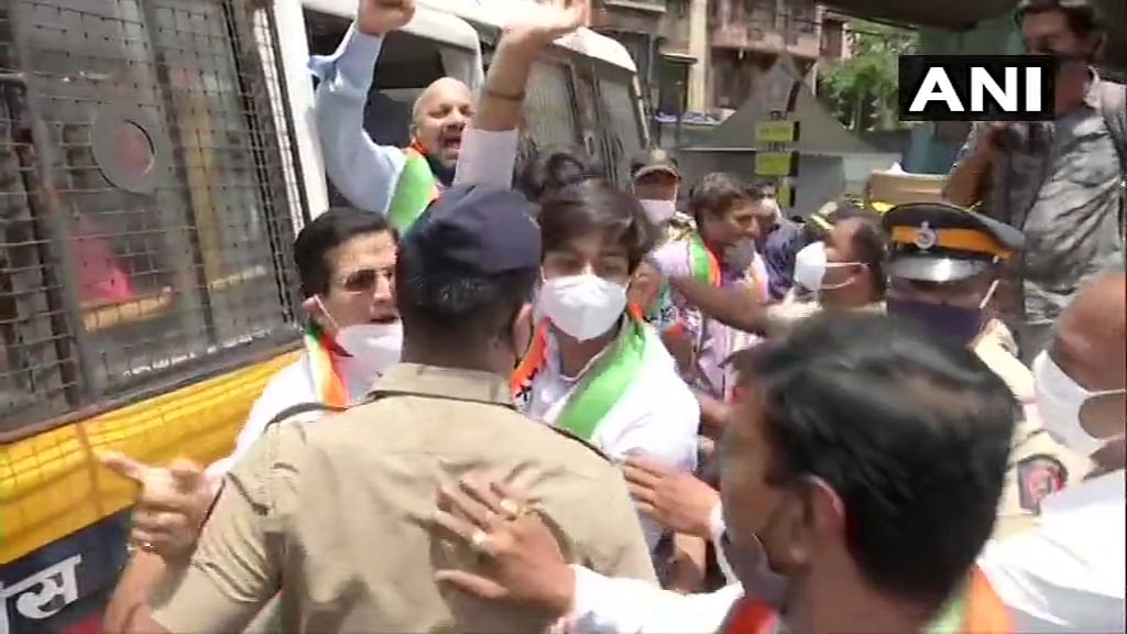 Nationalist Congress Party (NCP) workers detained during a protest against hike in LPG prices in Mumbai