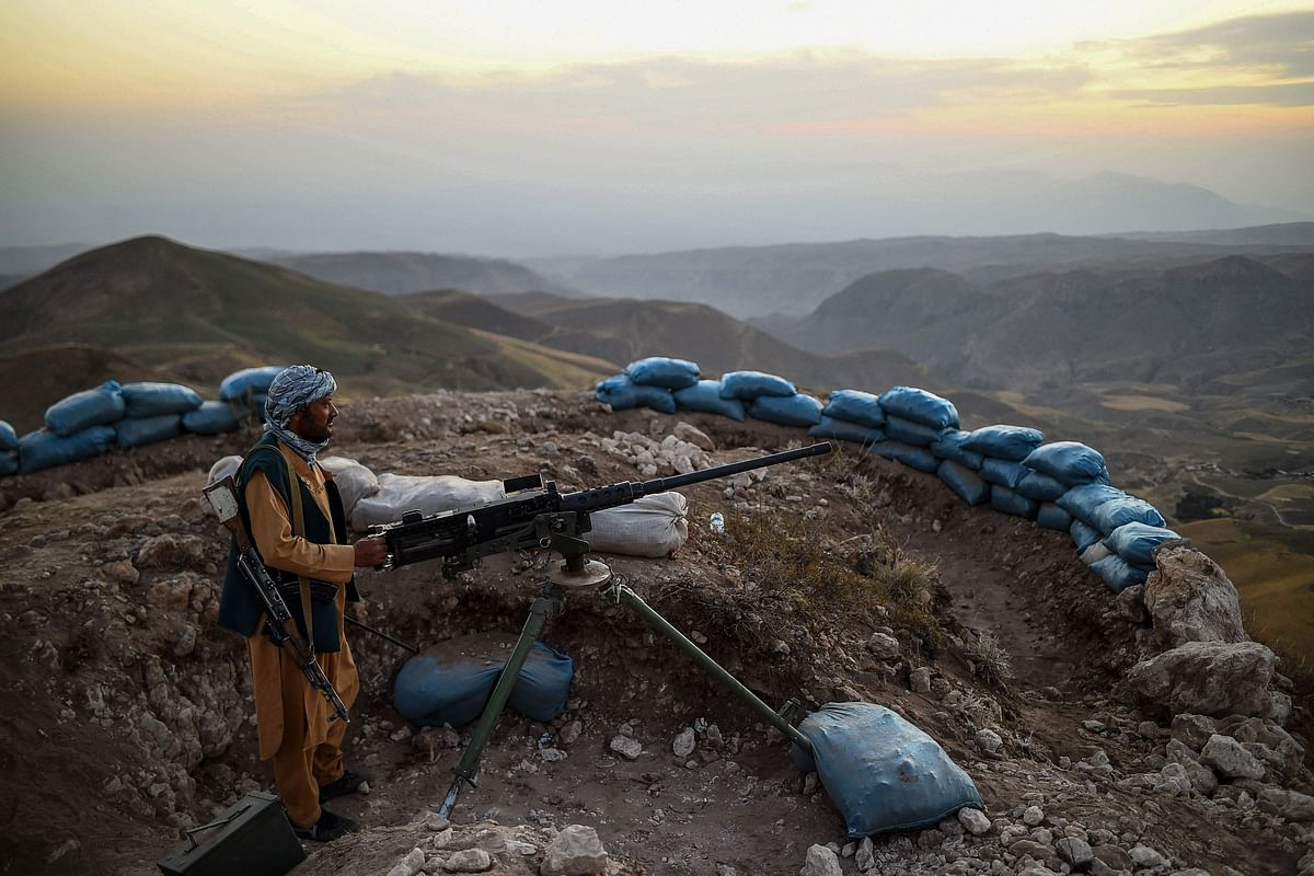 An Afghan militia fighter keeps a watch at an outpost against Taliban insurgents in Balkh Province.