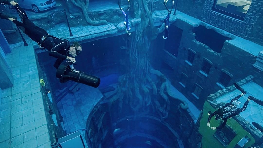 Watch Video: Dubai opens world's deepest pool complete with sunken city and underwater film studio