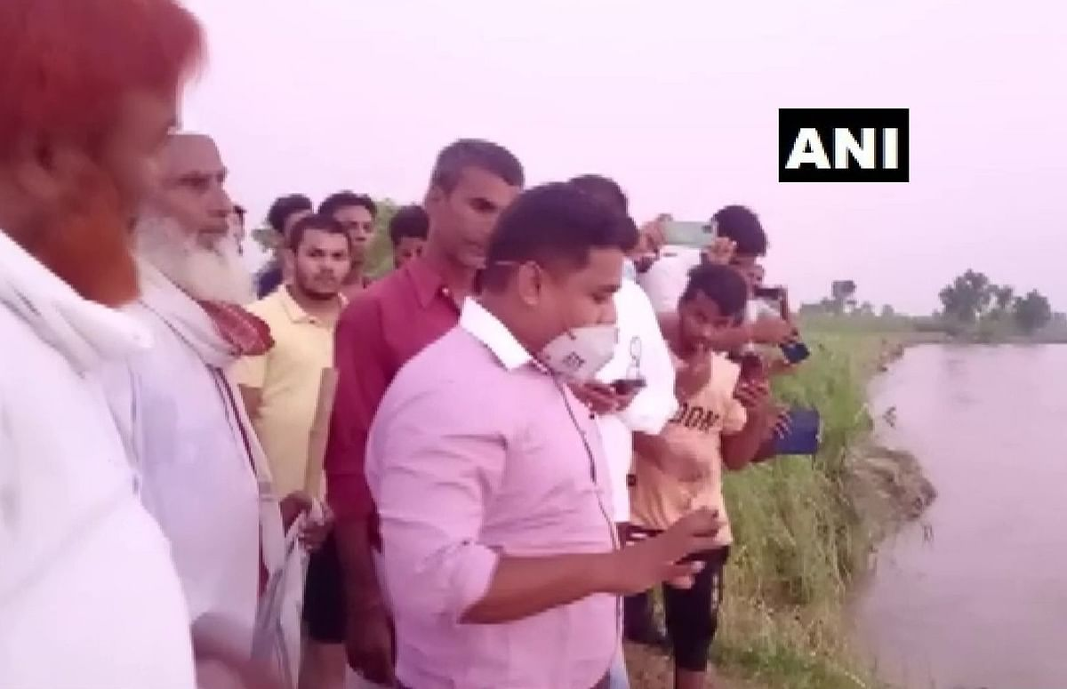 Bagaha SDM Shekhar Anand rode a buffalo cart to reach a river embankment in the flood-affected Ramnagar area in East Champaran, Bihar on July 5, 2021.