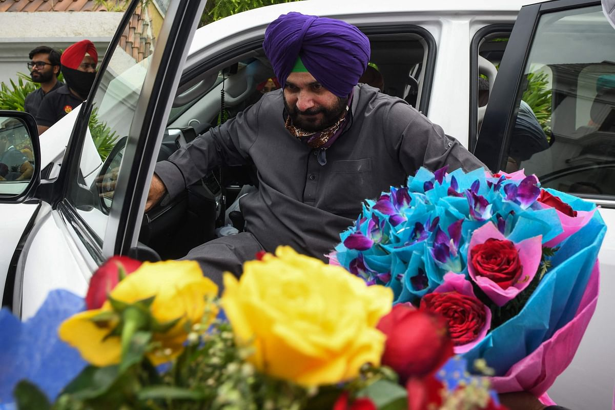 Newly appointed Punjab Congress party president Navjot Singh Sidhu arrive to meet with Congress party leaders ,in Amritsar on July 22, 2021.