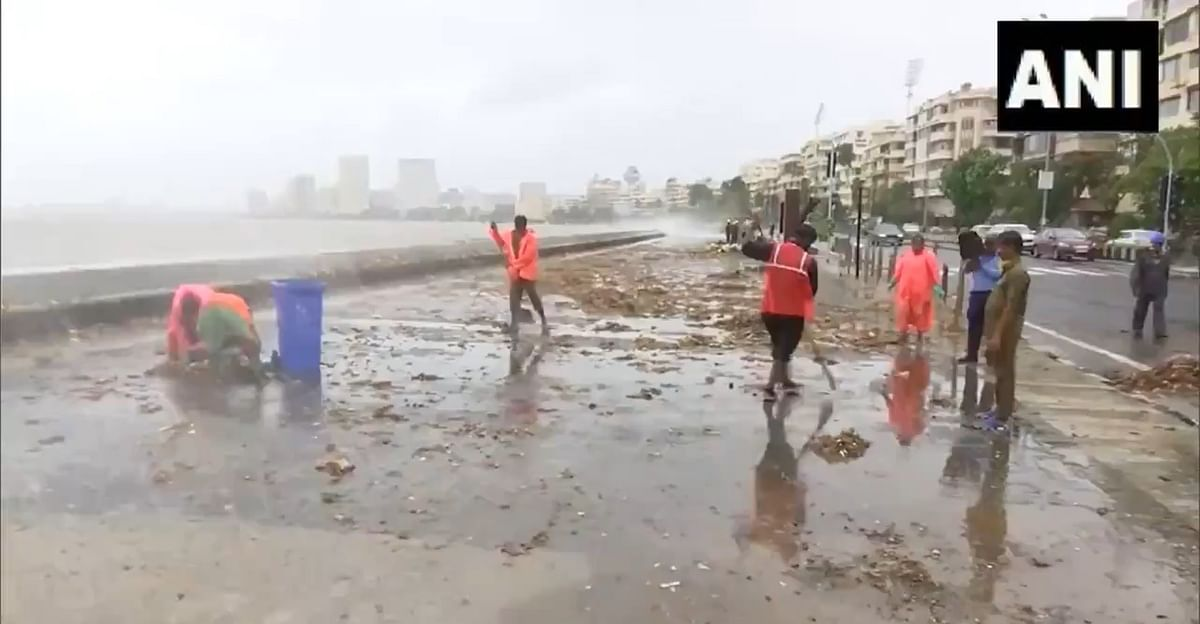 Watch Video: BMC workers clean garbage spewed by sea as high tide hits Mumbai's Marine Drive amid rainfall