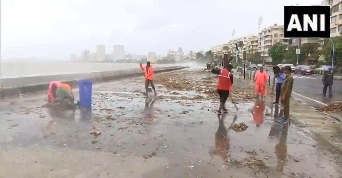 BMC workers clean garbage spewed by sea as high tide hits Mumbai's Marine Drive
