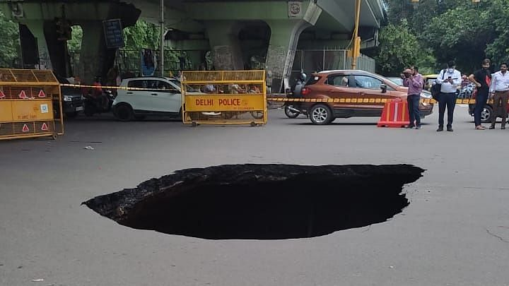 In Pictures: Massive chunk of road caves in near Delhi's IIT traffic light; netizens aghast
