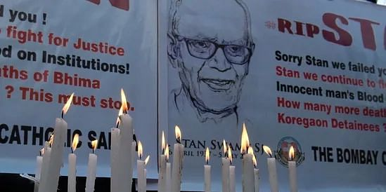People light candles, hold posters outside St Peter's Church, Bandra where a memorial mass was held for the Human rights activist and Jesuit priest Father Stan Swamy on Tuesday, July 6, 2021