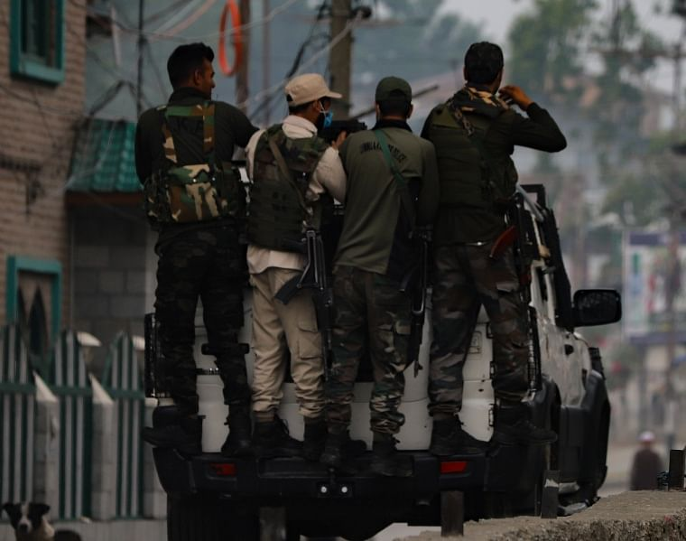 Security personnel during an encounter with militants in Pulwama town, south of Kashmir,