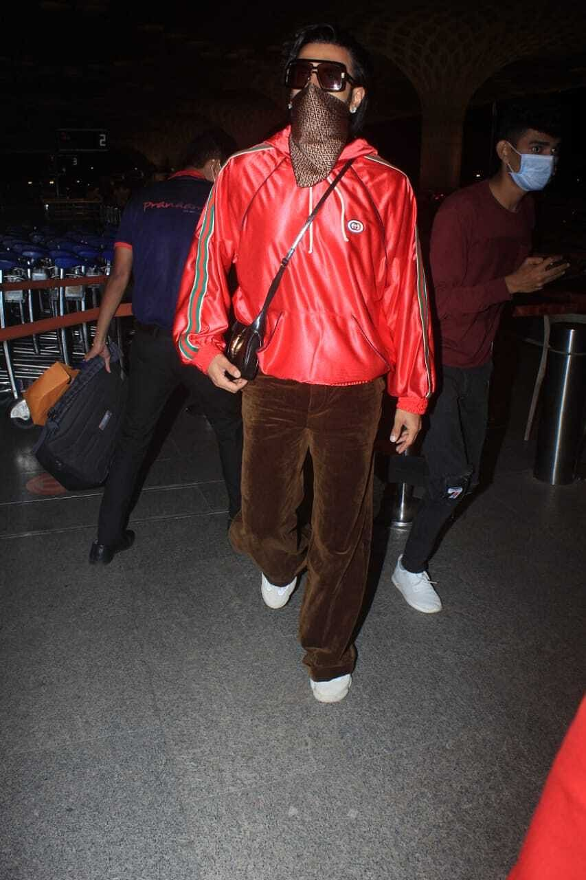 In Pics: Ranveer Singh spotted wearing a shiny sweatshirt worth Rs 1.15 lakh at Mumbai airport