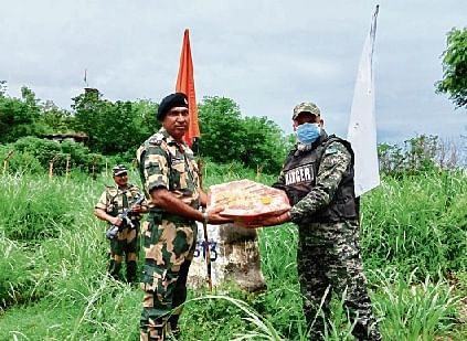 BSF men exchange sweets with Pak Rangers at the International Border in Jammu.