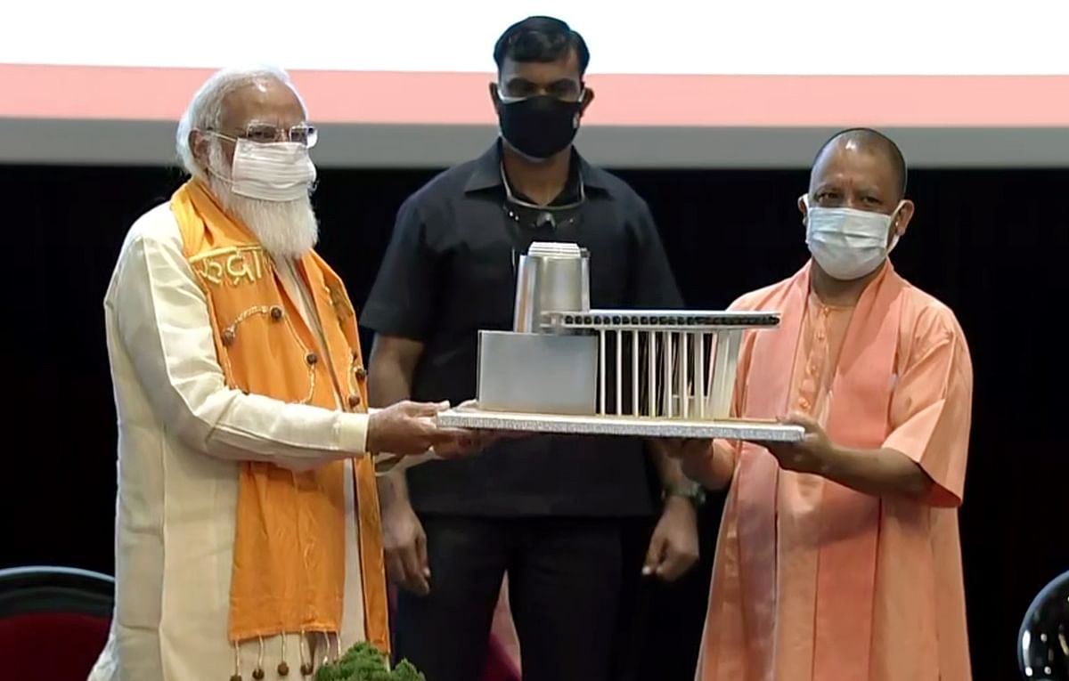 Prime Minister Narendra Modi being felicitated with a memento of Rudraksha Convention Centre by Uttar Pradesh CM Yogi Adityanath during the inauguration ceremony of Rudraksha Convention Centre, in Varanasi on Thursday.