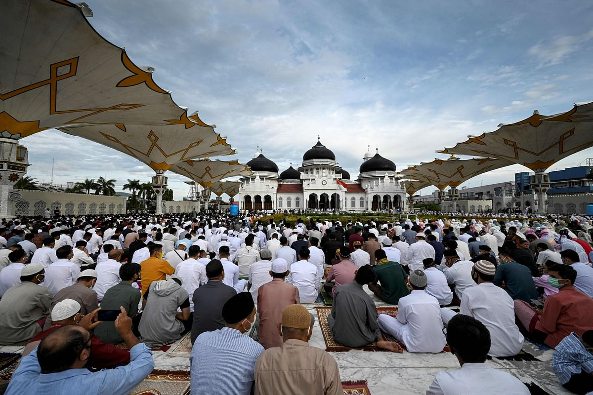 Muslims attend prayers to mark the Eid al-Adha festival at the Baiturrahman Grand Mosque in Banda Aceh on July 20, 2021.