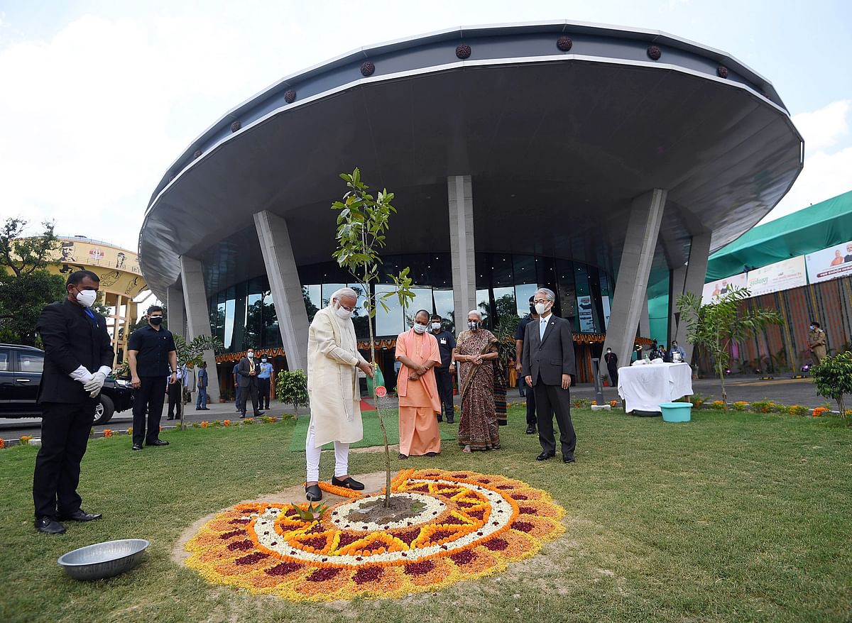 Prime Minister Narendra Modi planting a sapling at the inauguration of the International Cooperation and Convention Centre - Rudraksh, in Varanasi on Thursday.