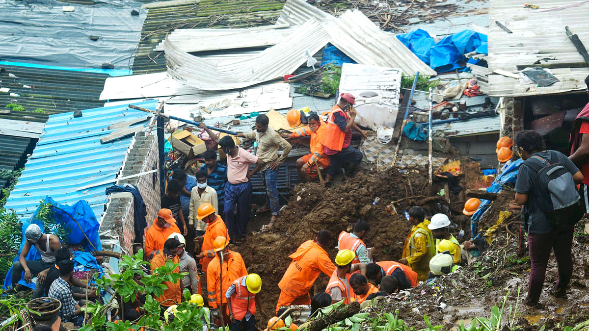 Maharashtra, July 18 (ANI): National Disaster Response Force (NDRF) conducts the inspects during a rescue operation after a wall collapses at Chemburs Bharat Nagar area due to a landslide, in Mumbai on Sunday.
