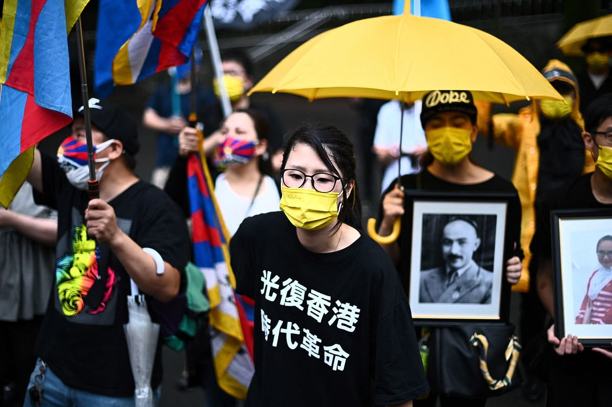Pro-democracy activists chant slogans before a march to protest against the 100th anniversary of the founding of the Communist Party of China, in Tokyos Shinjuku district on July 1, 2021.