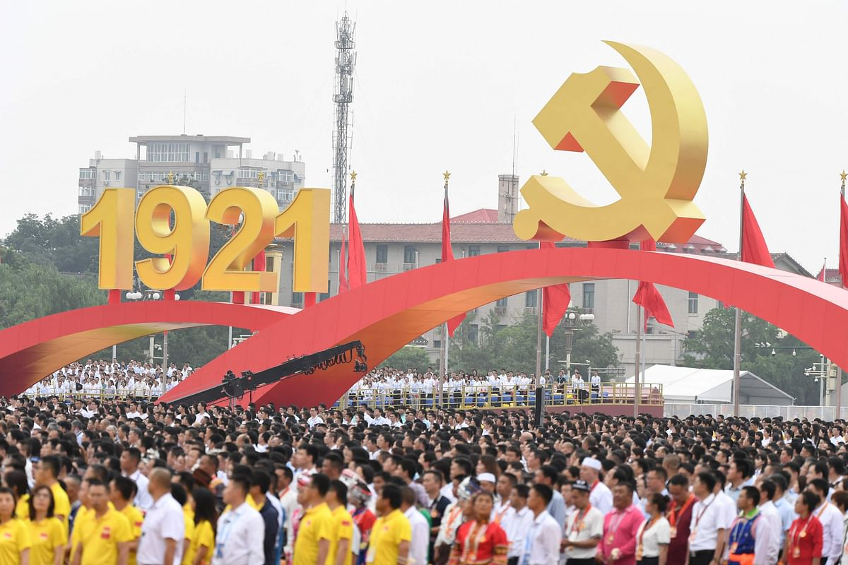 People attend the celebrations of the 100th anniversary of the founding of the Communist Party of China at Tiananmen Square in Beijing on July 1, 2021.