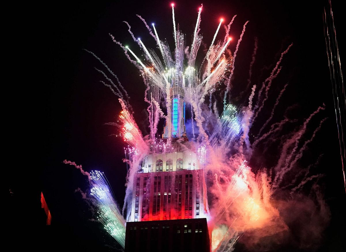The Empire State Building lights up with fireworks launched from the 72nd, 86th, and 103rd floors on July 4, 2021, to go along with the 2021 Macys 4th Of July Fireworks Show in New York City to mark Independence Day.