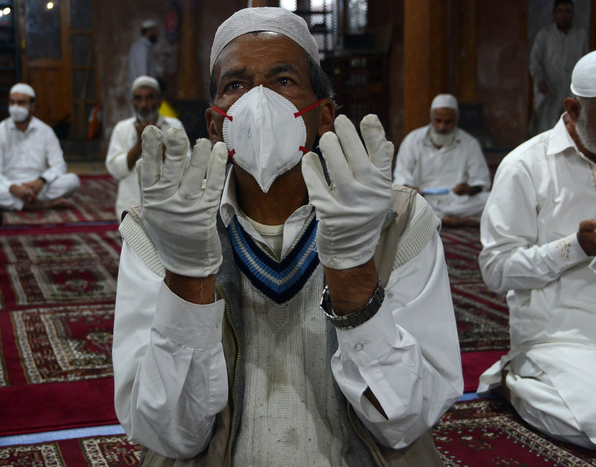 A man offers Eid-ul-Adha prayers wearing mask and gloves as a precautionary measure against COVID-19 at Aali Masjid in Srinagar,   Jammu & Kashmir on 21 July, 2021.