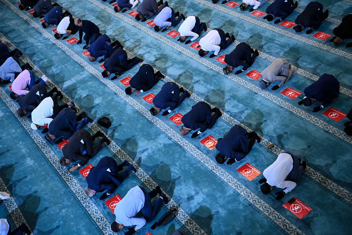 Russian Muslims gather in the Sobornaya mosque, Moscow Cathedral Mosque on July 20, 2021 during celebrations of Eid al-Adha (Kurban Bairam).