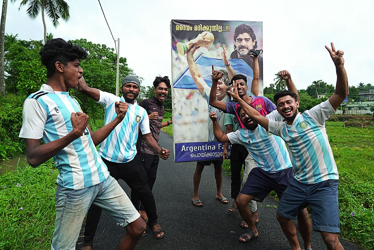 Fans of Argentina celebrate after winning the Conmebol 2021 Copa America football tournament final match against Brazil, in Kurumassery village, about 40 km from Kochi in the Indian state of Kerala on July 11, 2021.