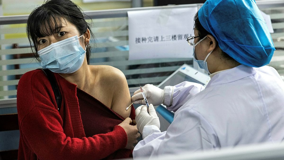 China threatens to ban unvaccinated citizens from public places