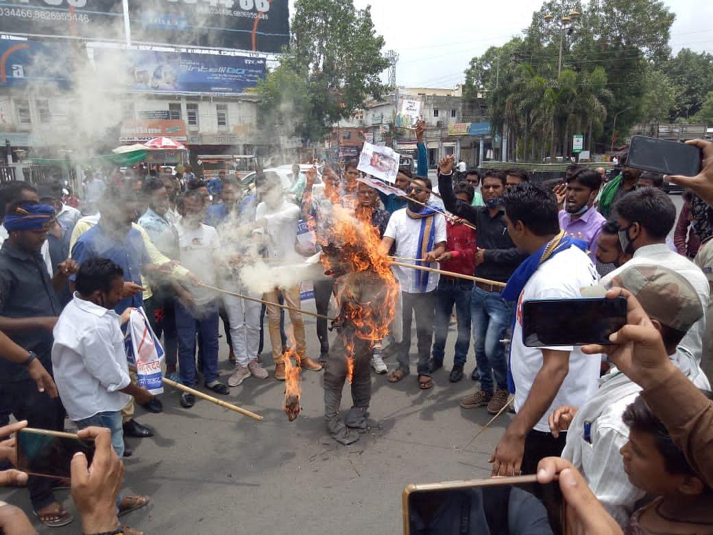 Bhim Army activists burn the effigy of Umakant Maharaj