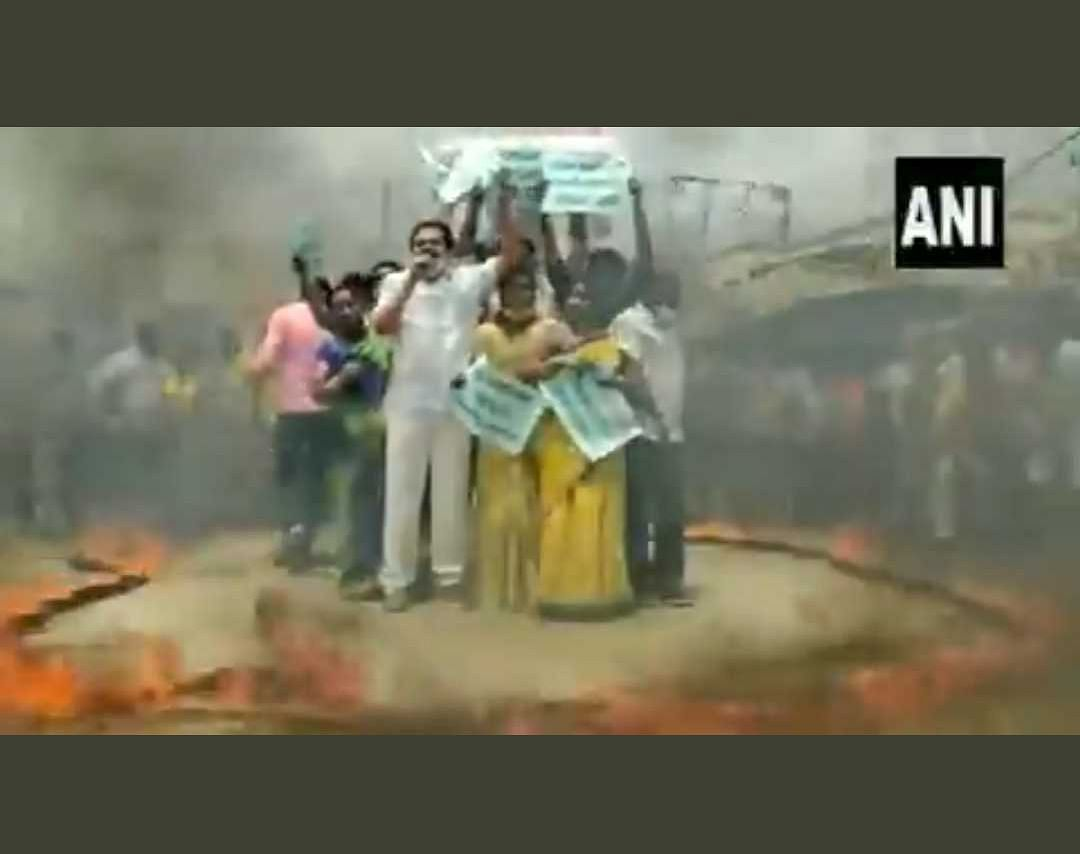 Watch Video: TDP workers protest against rising fuel prices by standing inside ring of fire in Andhra Pradesh