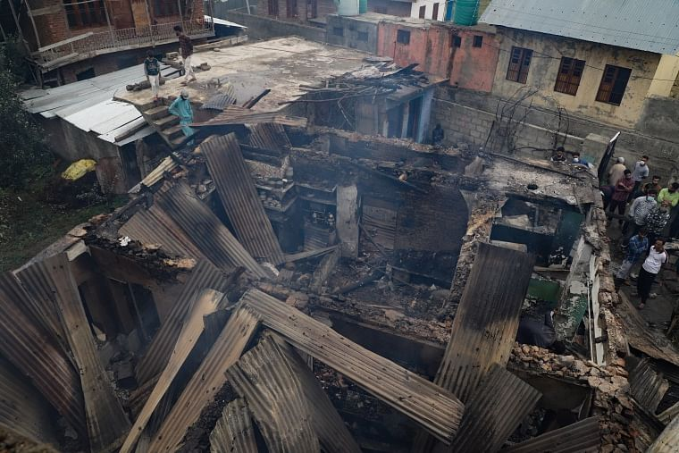 A view of a house damaged in an encounter between the security forces and militants  Pulwama town, South of Kashmir