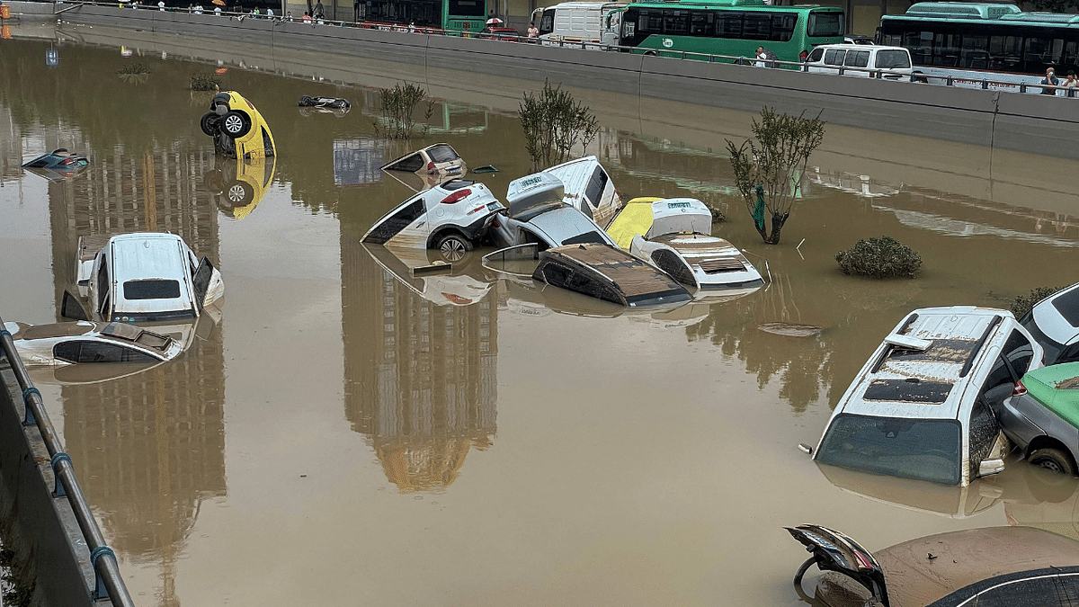 Submerged subways, paralysed traffic, lives lost- Devastating floods bring life in China to a halt; see photos