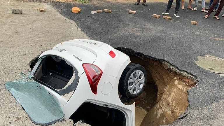 Watch Video: Car gets stuck as road caves in Delhi's Dwarka due to incessant rains