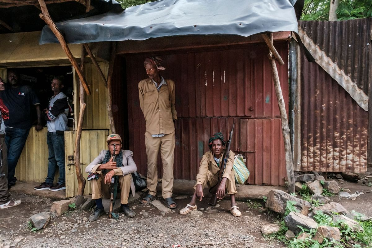 Members of the Amhara militia seat under a roof in the village of Adi Arkay, 180 kilometers northeast from the city of Gondar, Ethiopia, on July 14, 2021.