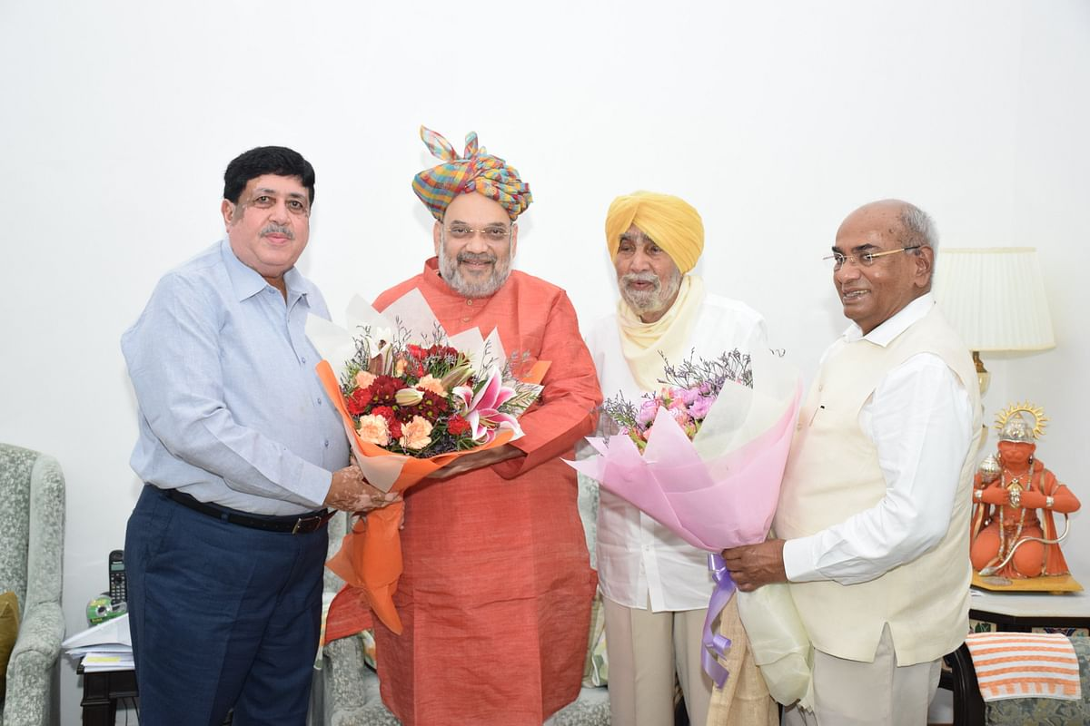 See Pics: Leading figures in co-operative sector meet Amit Shah, head of new ministry of cooperation