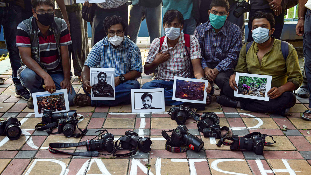 Kolkata: Photographers pay tribute to Pulitzer prize-winning photographer Danish Siddiqui, who was killed in Afghanistan, while covering a clash between Afghan security forces and Taliban fighters, in Kolkata, Friday, July 16, 2021.