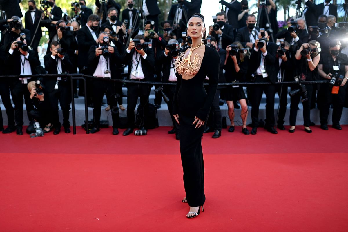 """US model Bella Hadid arrives for the screening of the film """"Tre Piani"""" (Three Floors) at the 74th edition of the Cannes Film Festival in Cannes, southern France, on July 11, 2021. (Photo by CHRISTOPHE SIMON / AFP)"""
