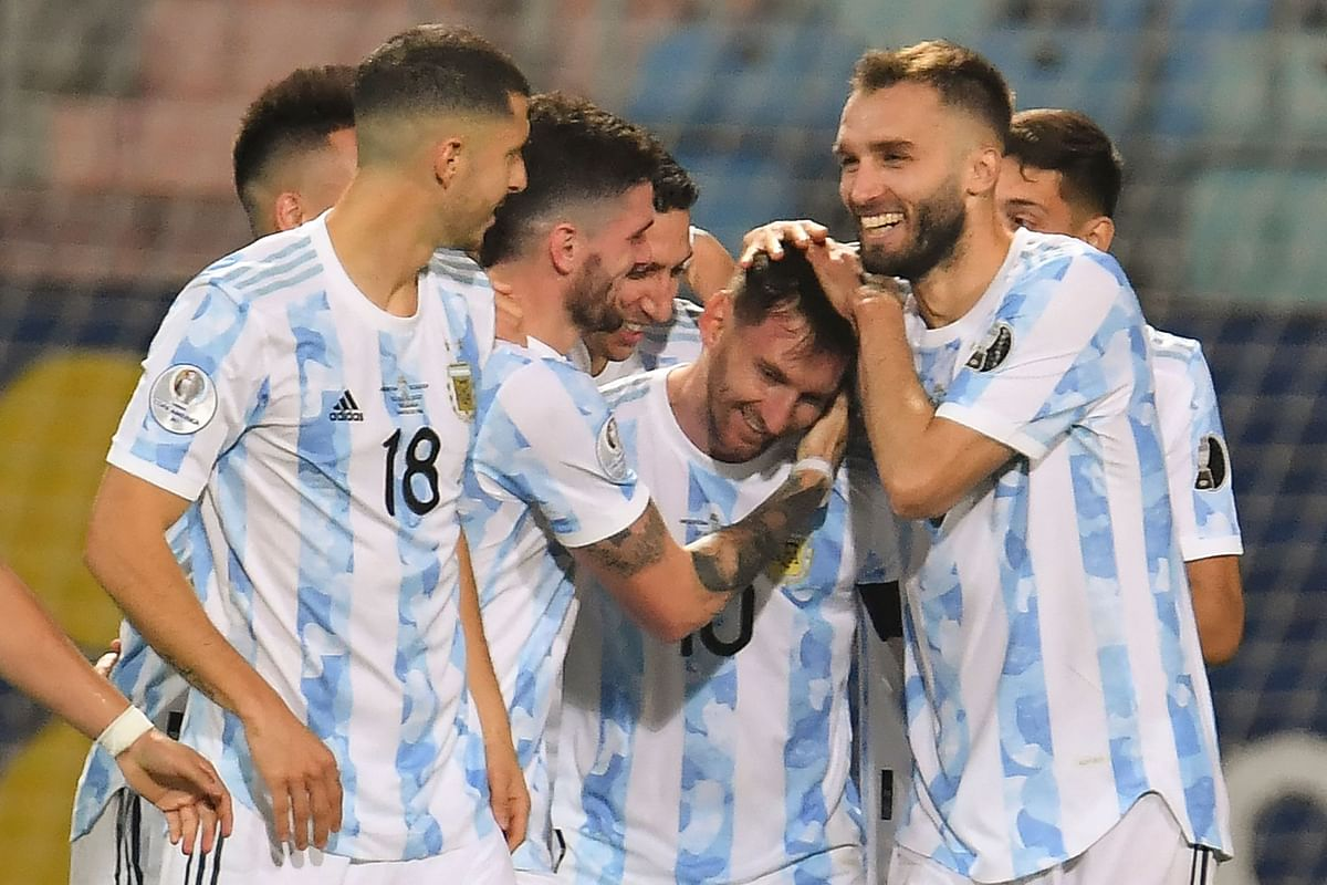 Argentian players celebrate with Lionel Messi