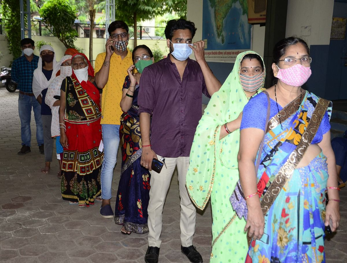 Beneficiaries wait for their turn for vaccination at Saraswati Shishu Mandir vaccination centre  on Monday