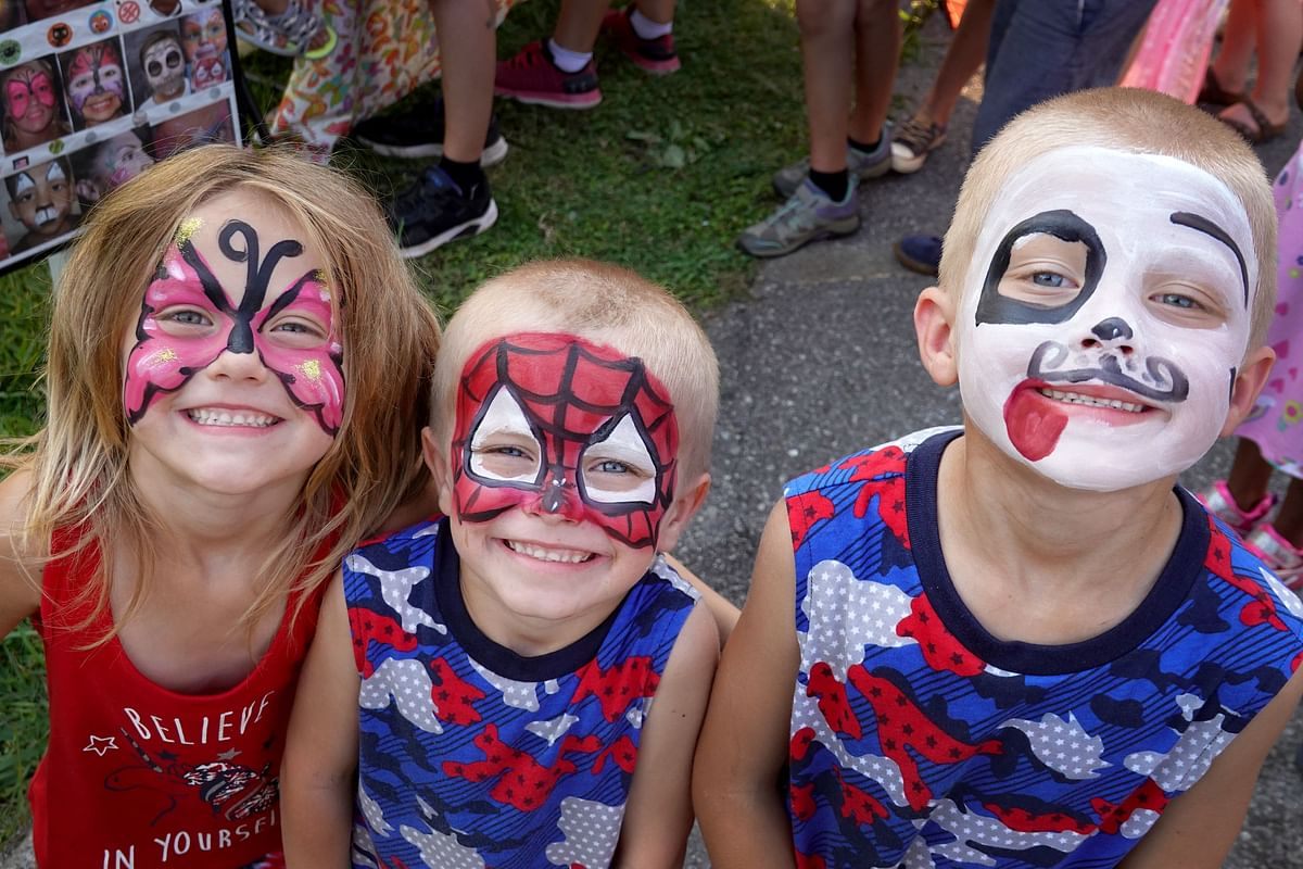 Children show off their freshly painted faces while celebrating Independence Day on July 04, 2021 in Sweetwater, Tennessee.