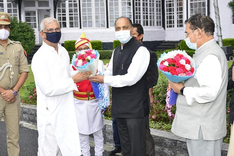 Governor of Himachal Pradesh Rajendra Vishwanath Arlekar being given a rousing reception on his arrival  by Chief Minister Jai Ram Thakur