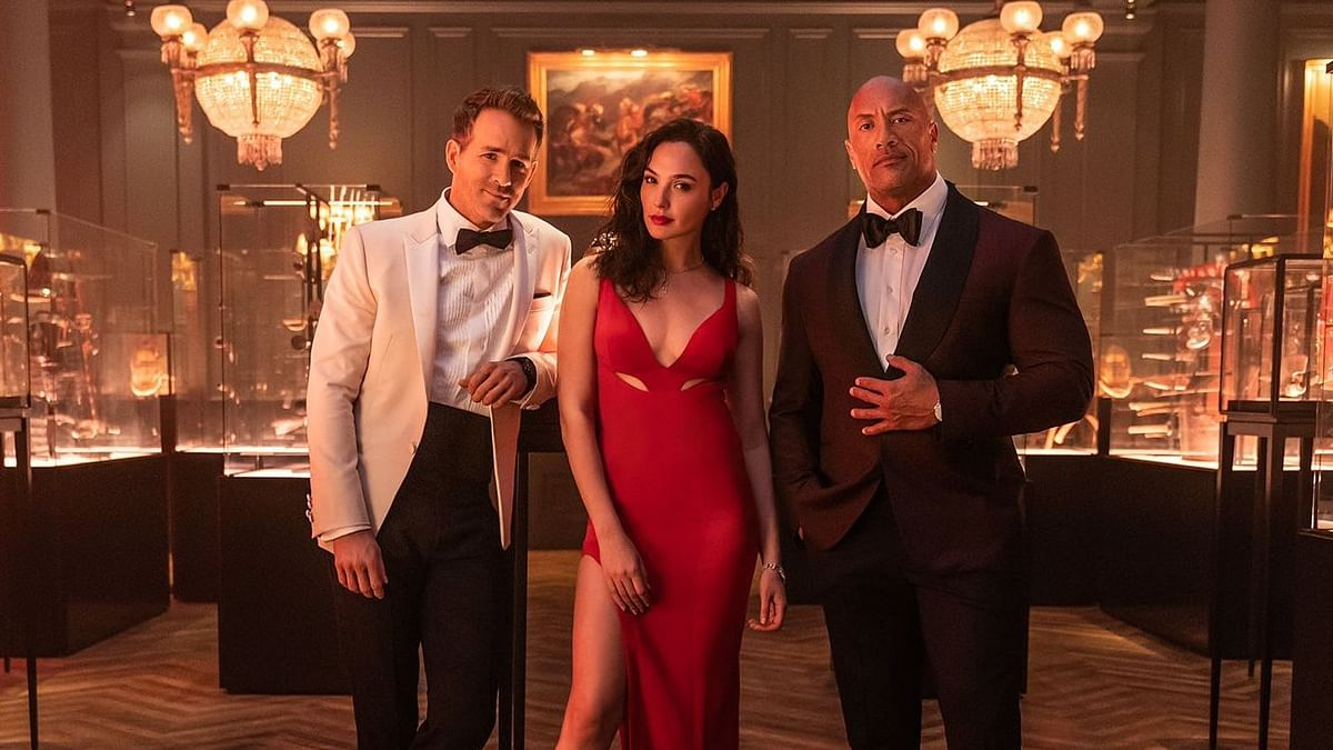 Red Notice: Netflix's 'biggest movie ever' starring Dwayne Johnson, Gal Gadot, and Ryan Reynolds to premiere in November