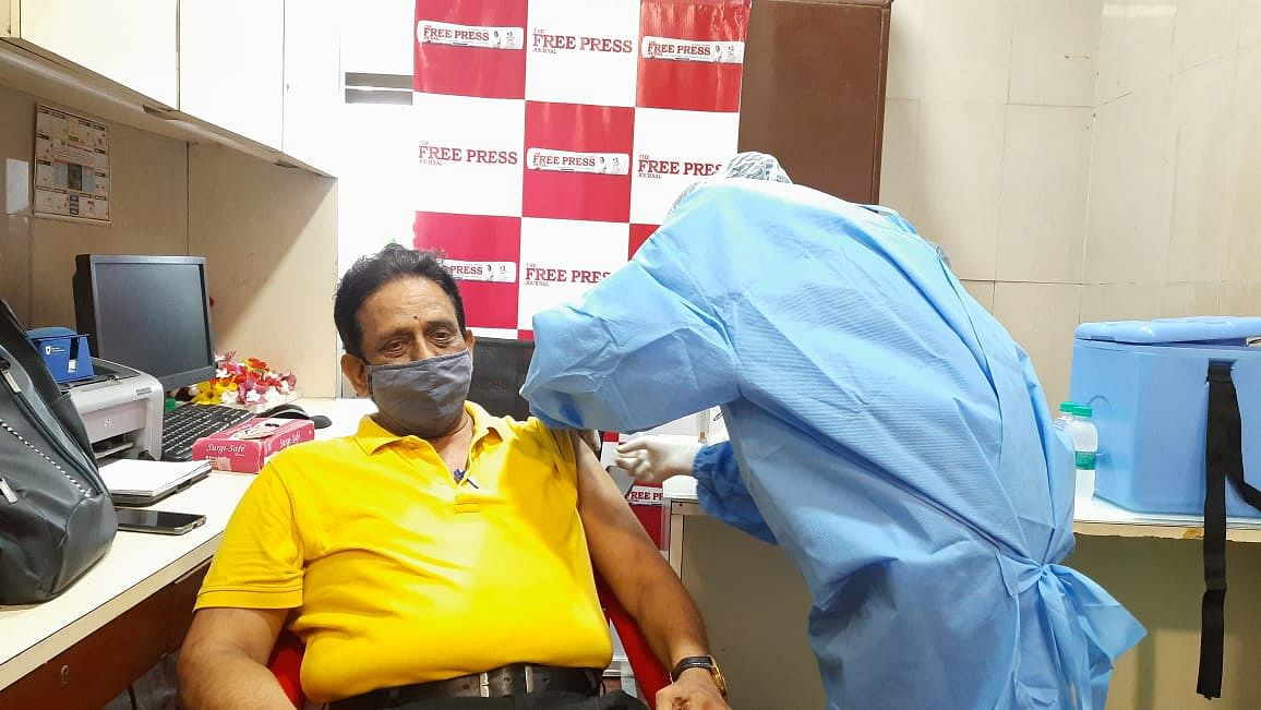 An employee of Free Press Journal being inoculated on Saturday.