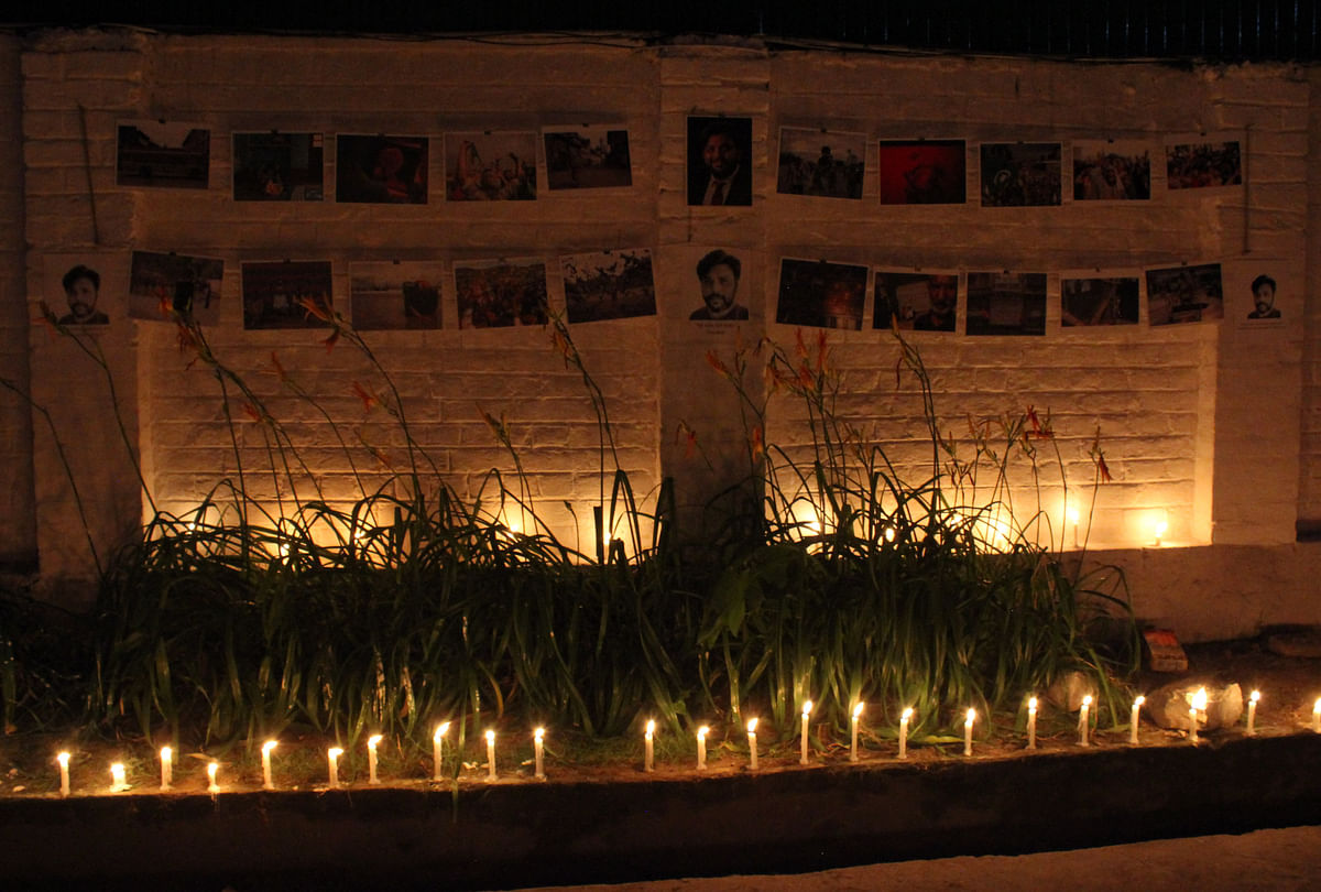 Kashmiri press photographers hold a candle vigil in memory of Reuters' photojournalist Danish Siddiqui inside the Kashmir Press Club in Srinagar, Jammu & Kashmir on July 18, 2021.
