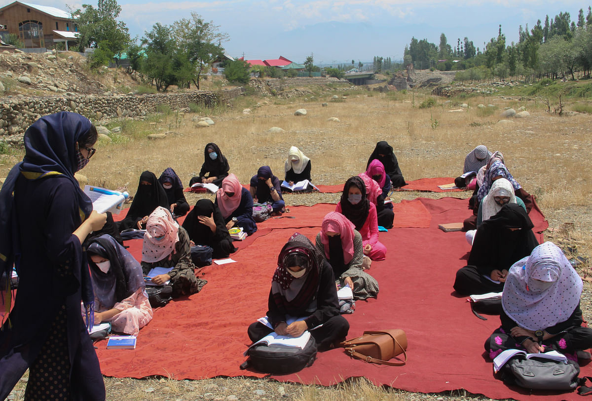 Visuals from an all-girls school conducting open-air classes in Tangmarg in Baramulla ditrict of Jammu & Kashmir.