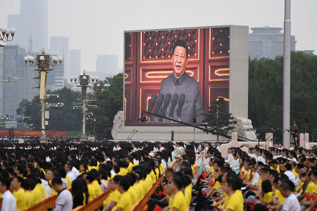 Chinese President Xi Jinping (C) delivers a speech during the celebration of the 100th anniversary of the founding of the Communist Party of China at Tiananmen Square in Beijing on July 1, 2021.