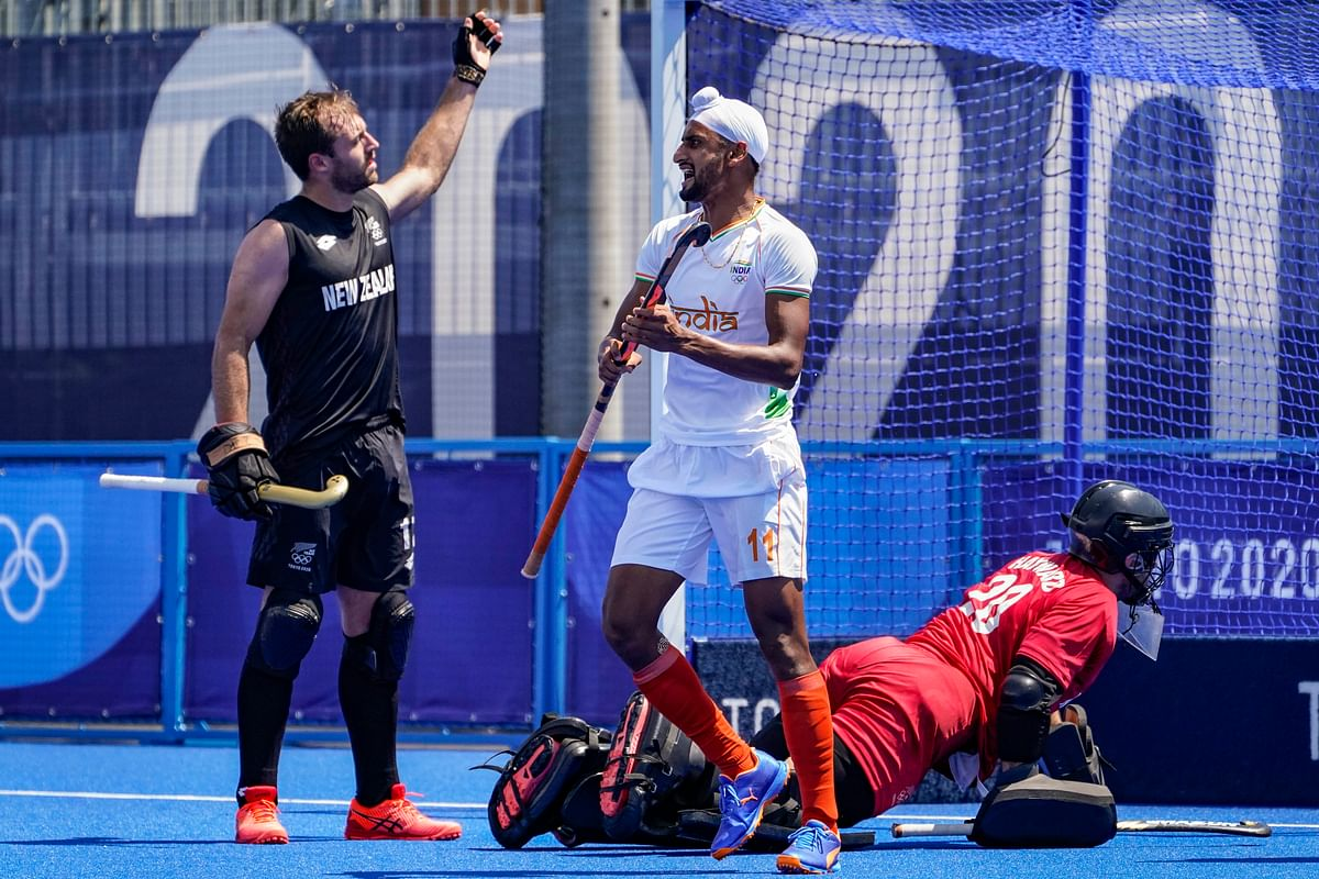 Mixed day of fortune for hockey teams; Men  edge out New Zealand, while the Netherlands crush India 5-1