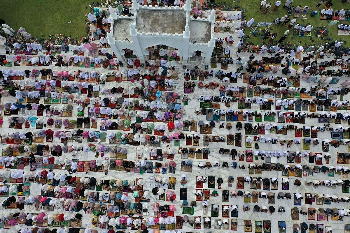 This aerial picture taken on July 20, 2021 shows Muslims attending prayers to mark the Eid al-Adha festival at the Baiturrahman Grand Mosque in Banda Aceh, Indonesia.