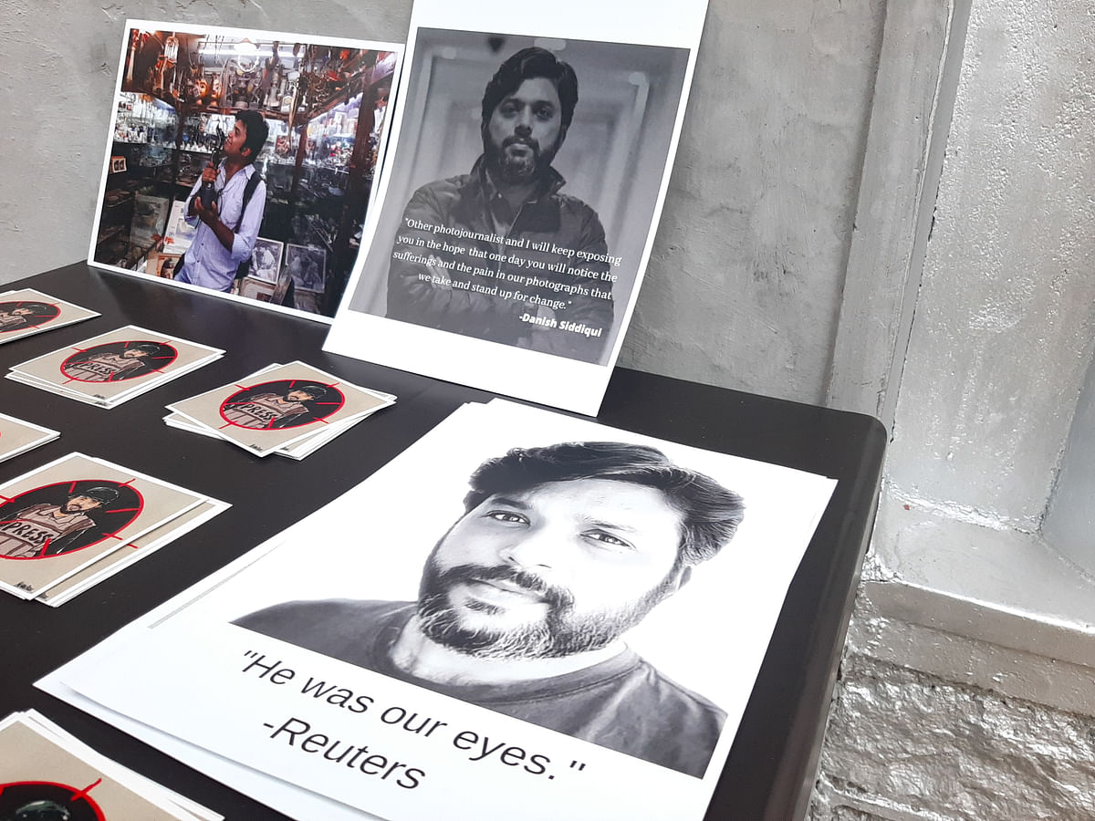 Photographs shot by Reuters photographer Danish Siddiqui are displayed along with his portrait inside the Kashmir Press Club as journalists light candles to pay tribute to him in Srinagar, Jammu & Kashmir on July 18, 2021.